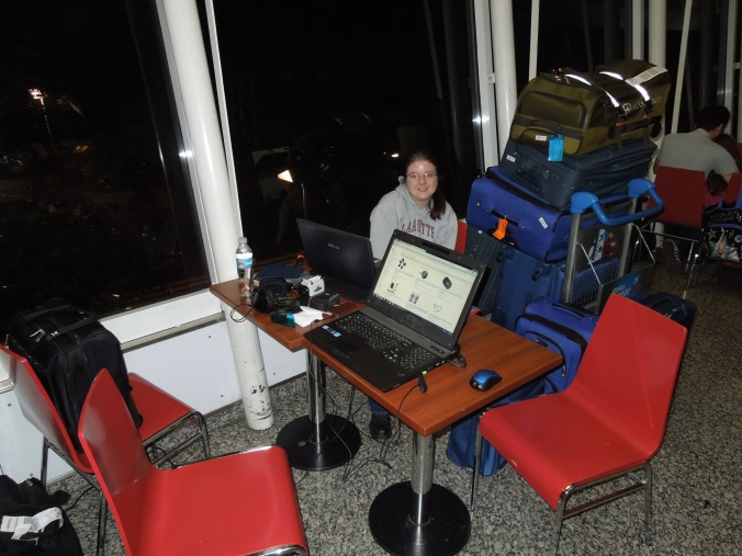 Our tower of luggage and table full of tech while stuck for the night at Aeroparque.
