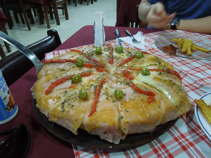 Our absurdly huge pizza from last night. Filled with chicken, cheese, ham (which is on everything), and more cheese.